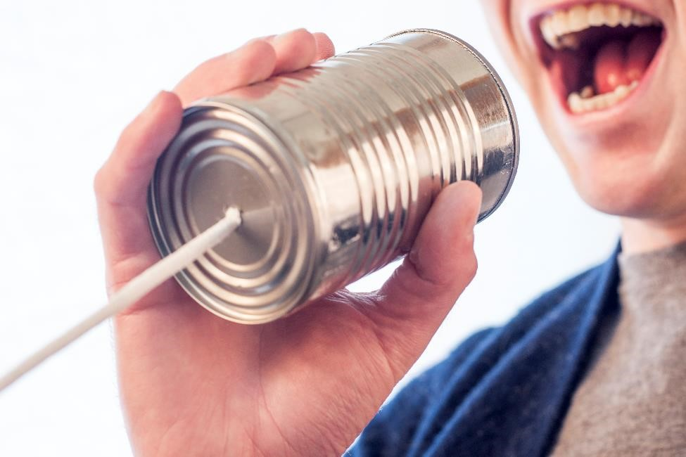Talking through a tin can phone