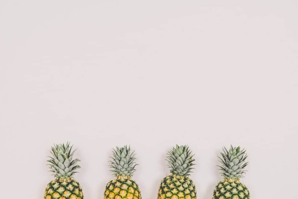 Four pineapples in a row